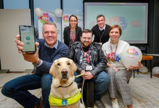 L-R: Gavin Neate, CEO and founder of Neatebox, Carolina Melendez, Customer Success Advisor at Neatebox, Neatebox service user Jon Attenbourgh with his guide dog Sam, Adam Mair, Brewing and Packaging Director at Diageo, Heather Pritchard, HRBP Strategic Projects at Diageo